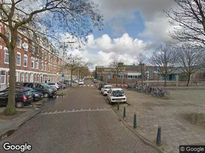 Ambulance met gepaste spoed naar Duivenvoordestraat in Rotterdam