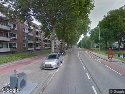 Ambulance met gepaste spoed naar Kerkwervesingel in Rotterdam