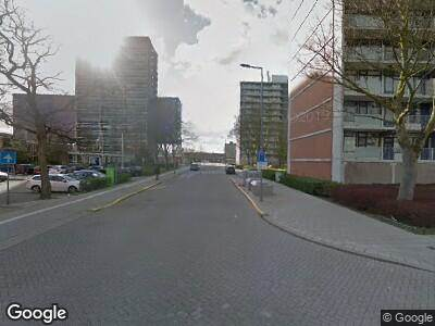 Ambulance met gepaste spoed naar Grote Hagen in Rotterdam