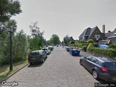 Ambulance met gepaste spoed naar Nicolaas Beetskade in Alkmaar
