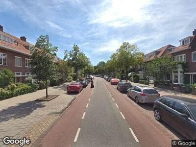 Ambulance met gepaste spoed naar Marnixstraat in Haarlem