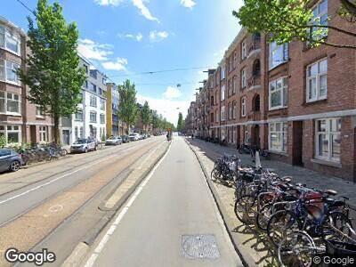 Ambulance met grote spoed naar Admiraal De Ruijterweg in Amsterdam