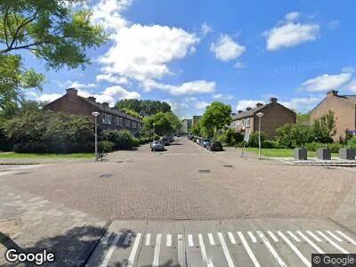 Ambulance met grote spoed naar Henriëtte Roland Holststraat in Amsterdam