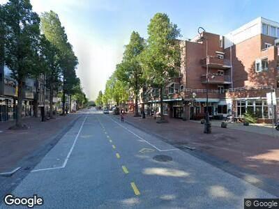 Ambulance met gepaste spoed naar Commelinstraat in Amsterdam