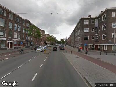 Ambulance met gepaste spoed naar Beukelsdijk in Rotterdam