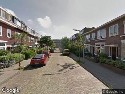 Ambulance met gepaste spoed naar Van der Meerstraat in Haarlem