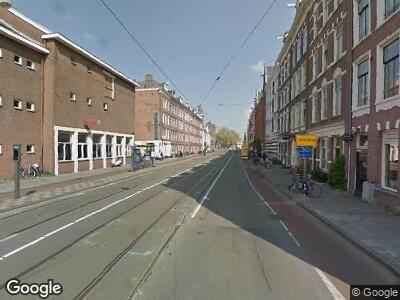 Ambulance met grote spoed naar Marnixstraat in Amsterdam