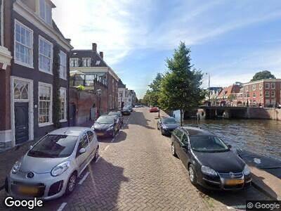 Ambulance met gepaste spoed naar Nieuwe Gracht in Haarlem