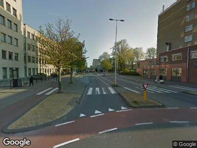 Ambulance met gepaste spoed naar Johan Jongkindstraat in Amsterdam