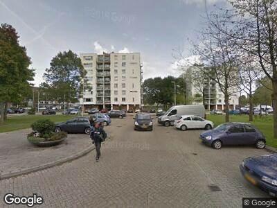 Ambulance met grote spoed naar Lieftinckplaats in Rotterdam