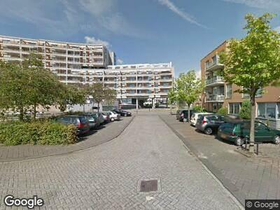Ambulance met gepaste spoed naar Justpier in Zaandam