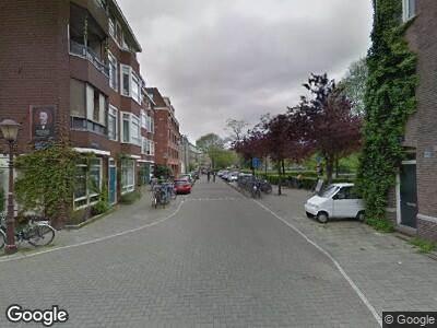 Ambulance met grote spoed naar Schimmelstraat in Amsterdam