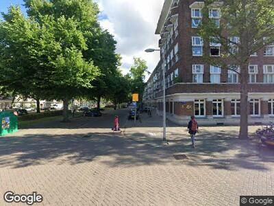 Ambulance met gepaste spoed naar Minervaplein in Amsterdam