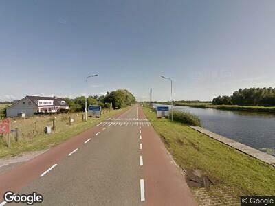 Ambulance met gepaste spoed naar Vijfhuizerdijk in Vijfhuizen