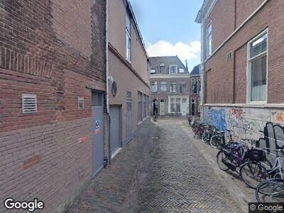 Ambulance met gepaste spoed naar Korte Rozenstraat in Haarlem