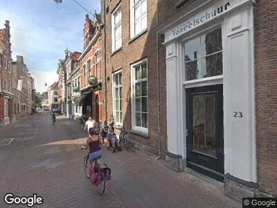 Ambulance met grote spoed naar Smedestraat in Haarlem