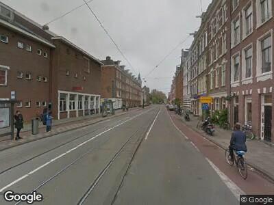 Ambulance met gepaste spoed naar Marnixstraat in Amsterdam