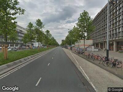 Ambulance met grote spoed naar Wibautstraat in Amsterdam