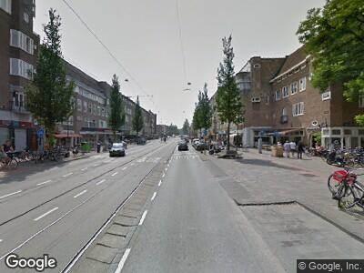 Ambulance met gepaste spoed naar Rijnstraat in Amsterdam