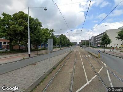 Ambulance met gepaste spoed naar Jan Tooropstraat in Amsterdam
