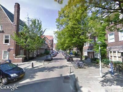 Ambulance met gepaste spoed naar Jan van Eijckstraat in Amsterdam