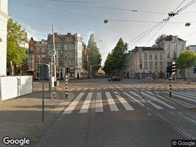 Ambulance met grote spoed naar Plantage Kerklaan in Amsterdam