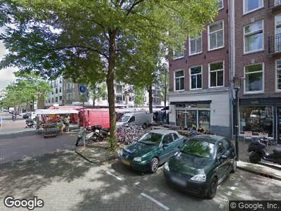 Ambulance met grote spoed naar Commelinstraat in Amsterdam