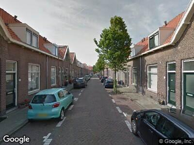 Ambulance met gepaste spoed naar Houttuinen in 's-Gravenhage