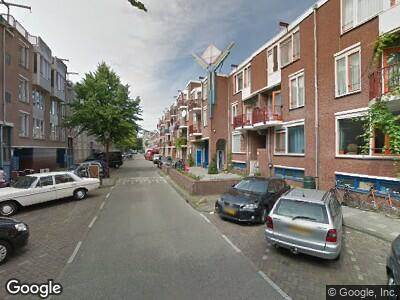 Ambulance met gepaste spoed naar Reinwardtstraat in Amsterdam