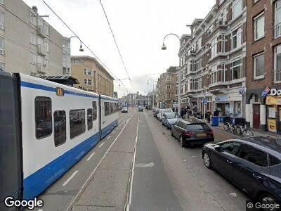 Ambulance met gepaste spoed naar Linnaeusstraat in Amsterdam