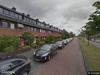 Ambulance met grote spoed naar Laan van Wateringse Veld in 's-Gravenhage