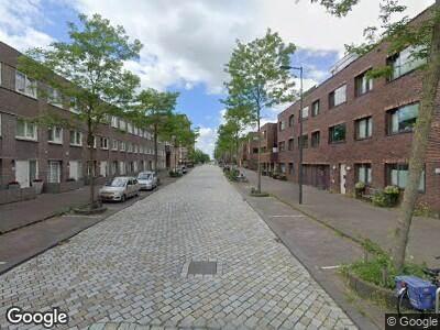 Ambulance met grote spoed naar Eva Besnyöstraat in Amsterdam