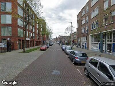 Ambulance met grote spoed naar Jan Kruijffstraat in Rotterdam