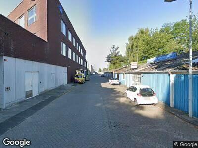 Ambulance met gepaste spoed naar Karperweg in Amsterdam