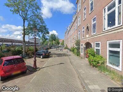Ambulance met grote spoed naar Vlietstraat in Amsterdam