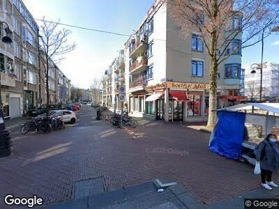 Ambulance met gepaste spoed naar Pieter Nieuwlandstraat in Amsterdam