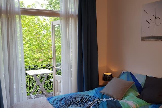 Prachtige kamer met balkon en gedeelde keuken