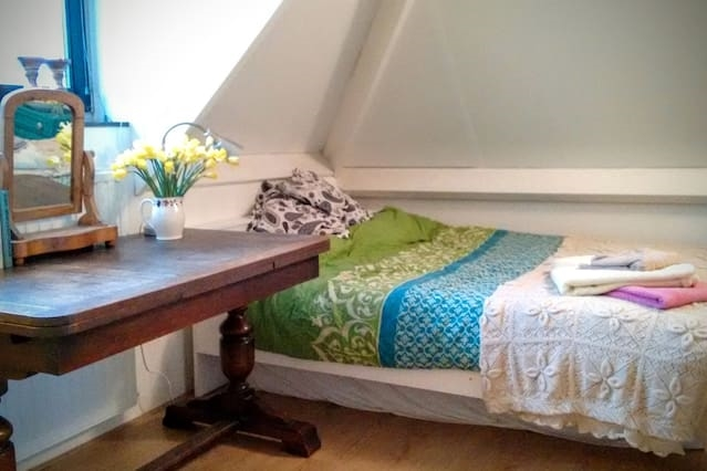 Cozy attic bedroom in shared house